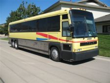 Yellow Charter Bus located outside of Chicago.